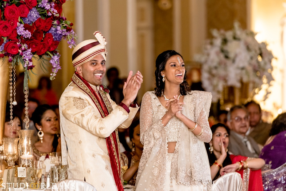 Indian wedding at the Roosevelt hotel - bride and groom clapping for the Bellytwins international