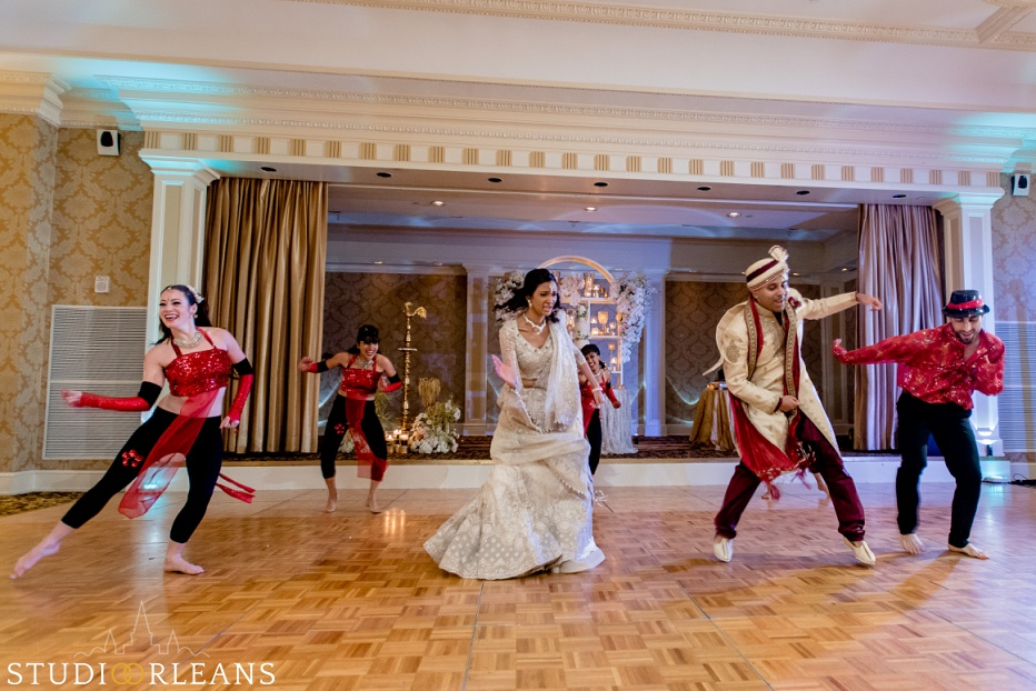 New Orleans Indian wedding reception -The Roosevelt hotel - bride and groom dancing with the Bellytwins international