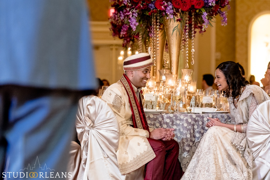 New Orleans Indian wedding reception -The Roosevelt hotel - bride and groom laughing with the Bellytwins international