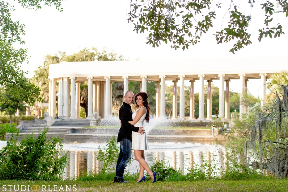 City Park Engagement Session in New Orleans with a couple standing under the amazing Oak trees