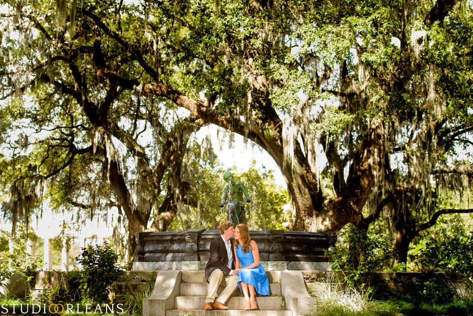 Engagement Session in City Park by the beautiful fountain with Oak trees in the background