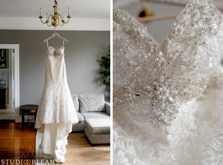 Beautiful wedding dress hanging from a chandelier