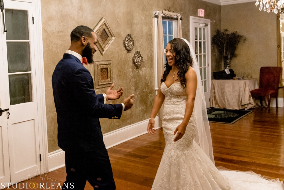 The groom gets ready for the first look at his bride. This was taken at Cedar Grove Plantation. Photo by Studio Orleans New Orleans Photographers