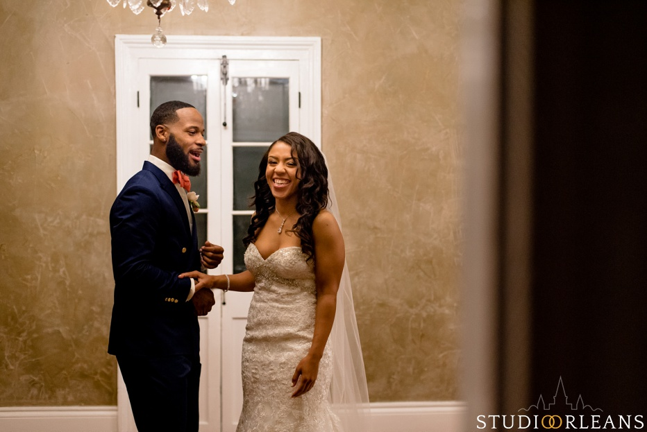 The groom sees his bride for the first time. This was taken at Cedar Grove Plantation. Photo by Studio Orleans New Orleans Photographers