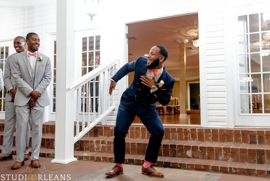 The groom dancing as it gets closer to his bride. This was taken at Cedar Grove Plantation. Photo by Studio Orleans New Orleans Photographers