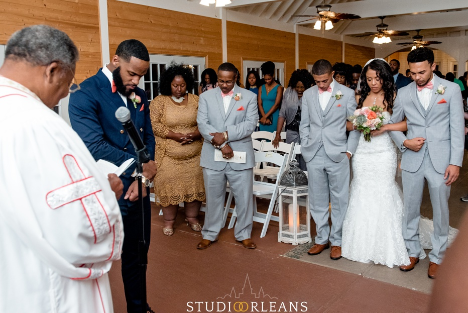 Everyone prays before the ceremony starts. This was taken at Cedar Grove Plantation. Photo by Studio Orleans New Orleans Photographers