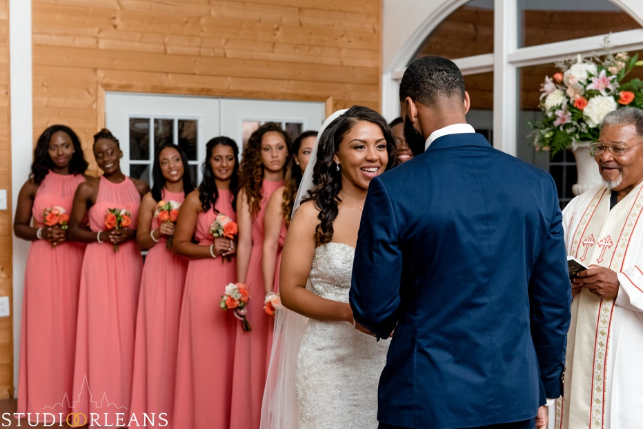 Checkout the way the bride looks at her groom and the bridesmaids watch. This was taken at Cedar Grove Plantation. Photo by Studio Orleans New Orleans Photographers