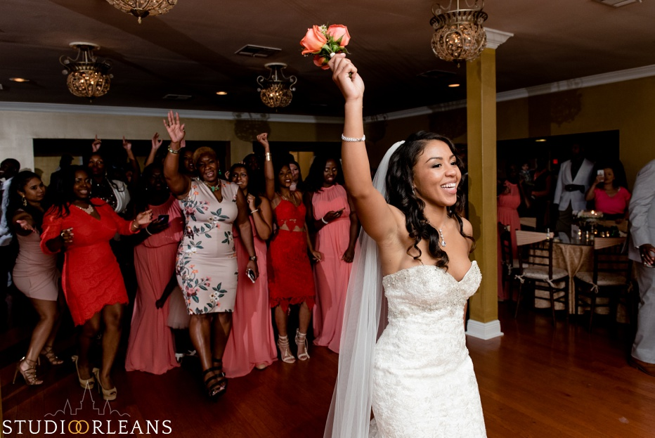 The bride throws her bouquet at Cedar Grove Plantation. Photo by Studio Orleans New Orleans Photographers