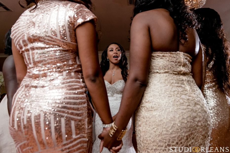 The bride sings and joked with her friends at Cedar Grove Plantation. Photo by Studio Orleans New Orleans Photographers