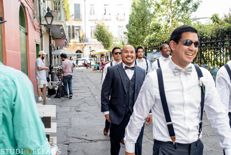 Groom walking to the Saint Louis Cathedral for his wedding in New Orleans