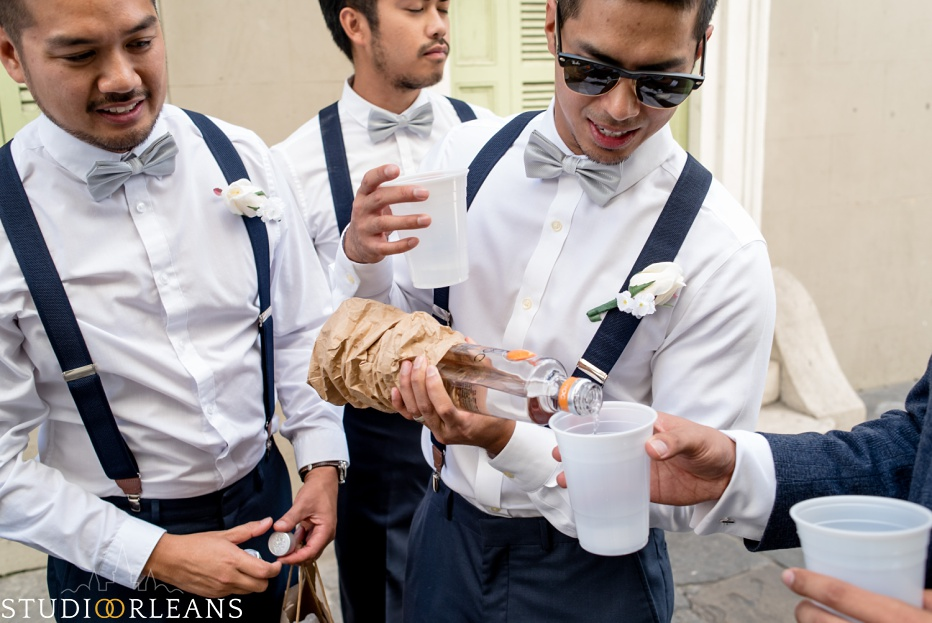 Groom and groomsmen getting ready for the wedding ceremony at the Saint Louis Cathedral in New Orleans