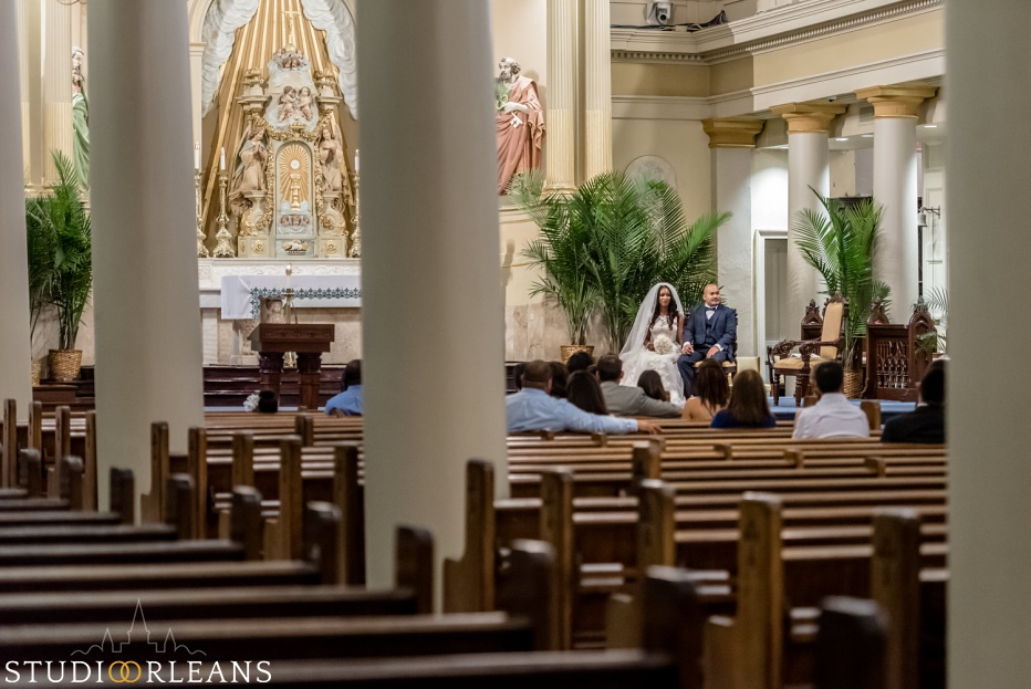 Bride and groom at the alter at the Saint Louis Cathedral in New Orleans