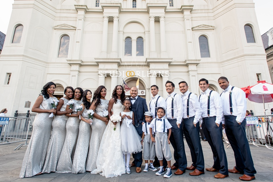 The bride, groom and bridal party outside of the Saint Louis Cathedral in New Orleans