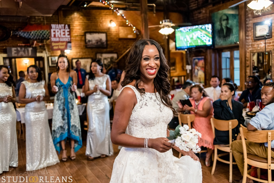 The bride is about to toss her bouquet to a lucky girl