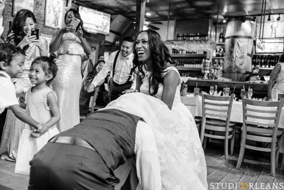 The groom searches for the garter at Oceana Grill in the French Quarter of New Orleans
