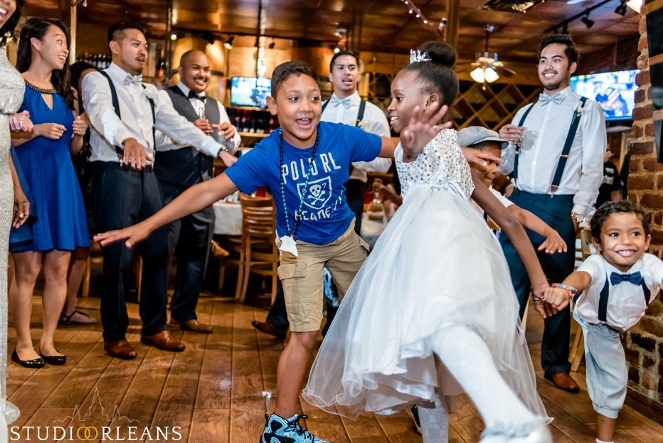 Kids dancing at a wedding at Oceana Grill in the French Quarter of New Orleans. An Oceana Grill Wedding
