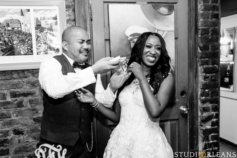 The groom feeds his bride cake at Oceana Grill in the French Quarter of New Orleans. An Oceana Grill Wedding