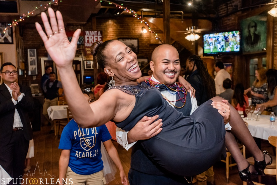 The groom picks up his new mother in law at the Oceana Grill in the French Quarter of New Orleans. An Oceana Grill Wedding