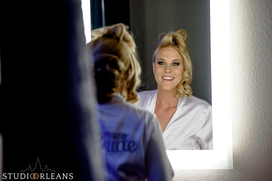 Chateau Lemoyne Wedding - Bride looking at herself in the mirror
