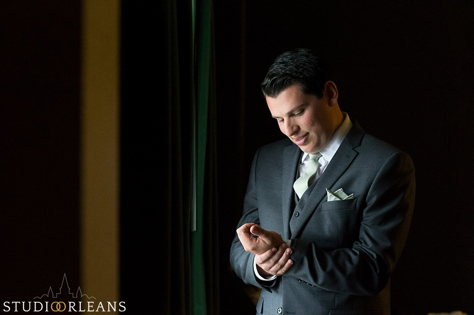 Chateau Lemoyne Wedding - The groom fixing his cuff link before the ceremony