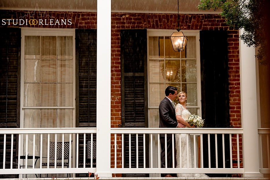 Bride and groom on the balcony at the Chateau Lemoyne Hotel in the French Quarter of New Orleans