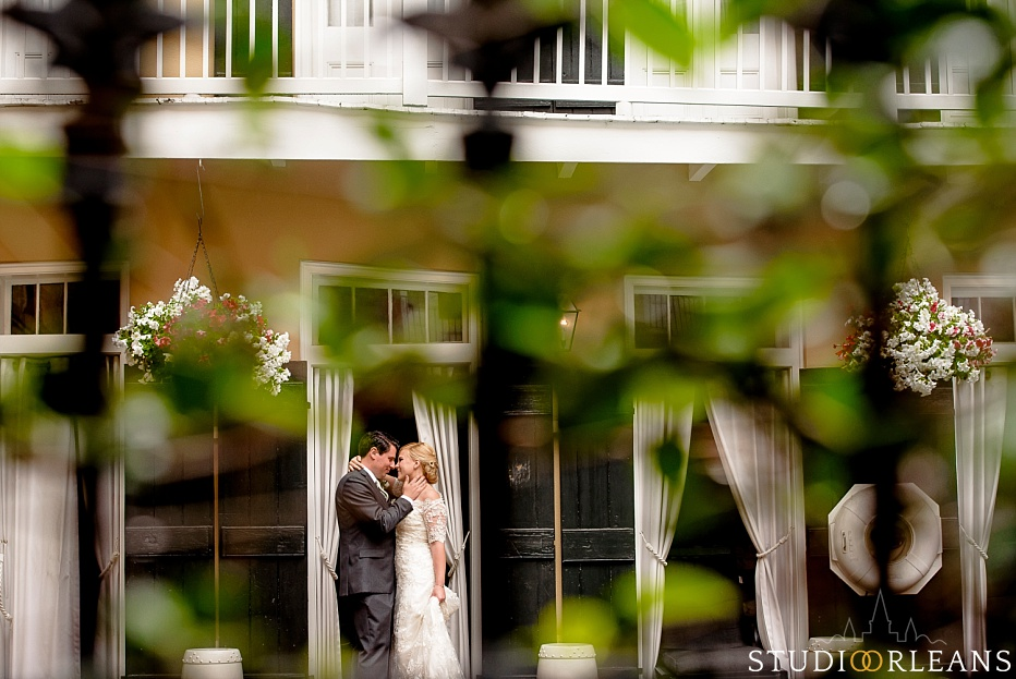 Bride and groom by the pool at the Chateau Lemoyne Hotel in the French Quarter of New Orleans