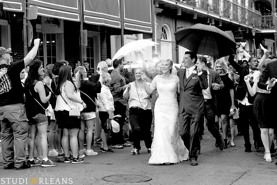 Kinfolk Brass band lead the newly married couple around the French Quarter to celebrate with a Second Line