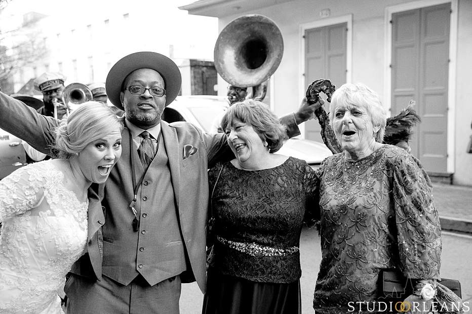 A bride with Kinfolk brass band singer, her mom and her new mother in law