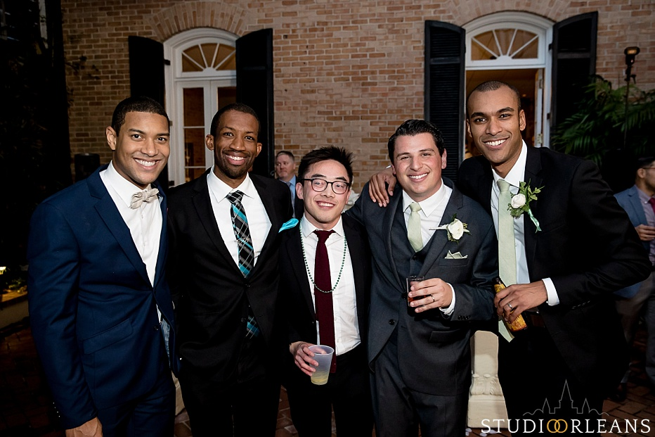 The groom with his college friends in the courtyard of Chateau Lemoyne hotel