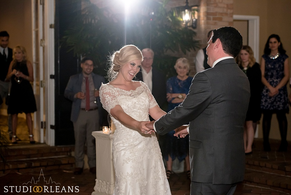 Bride and groom dance in the courtyard at the Chateau Lemoyne Hotel