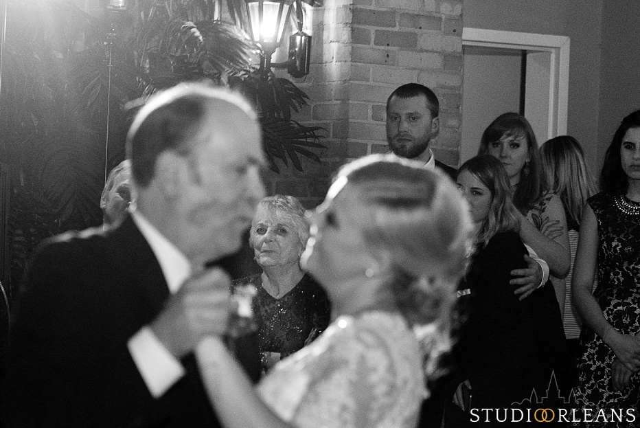 Bride and her father dance in the courtyard at the Chateau Lemoyne Hotel