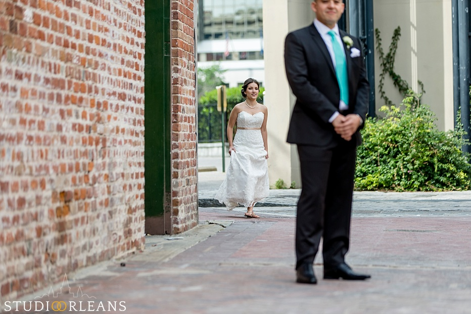The bride and groom do the first look neer the Old 77 hotel in New Orleans