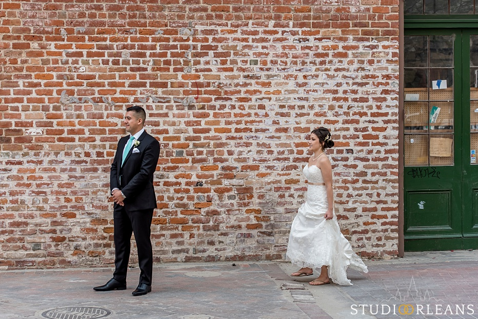 The bride and groom do the first look near the Old 77 hotel in New Orleans