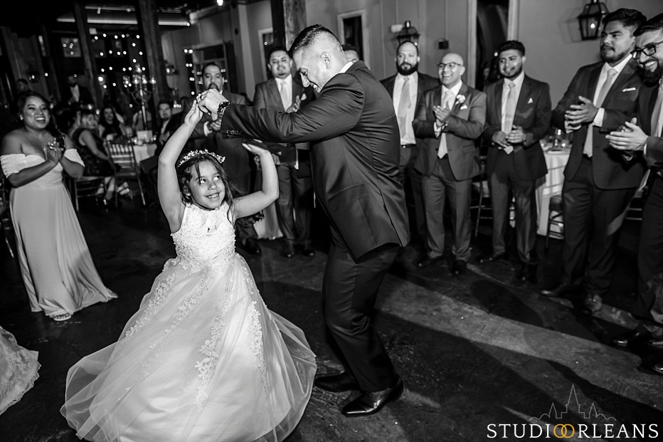 The groom dances with his daughter at the Chicory wedding venue in New Orleans