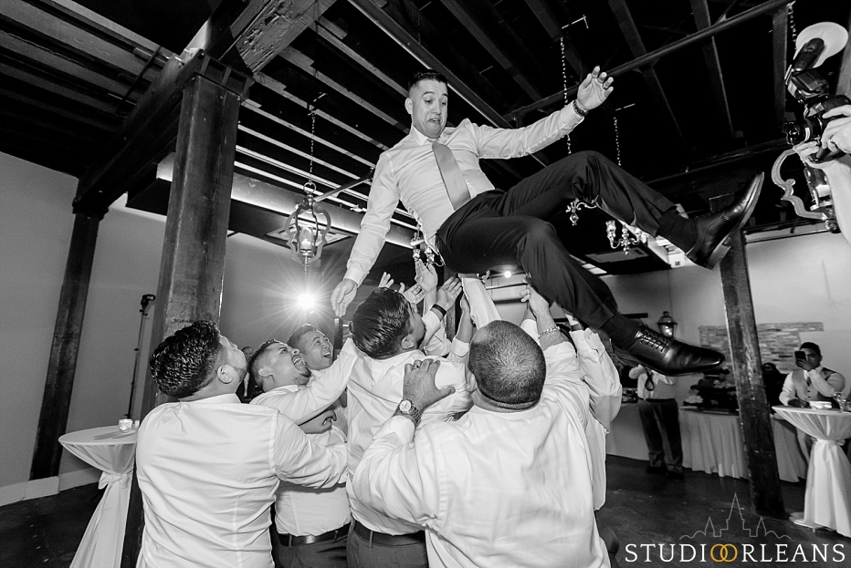 The groom gets thrown in the air at the Chicory wedding venue in New Orleans
