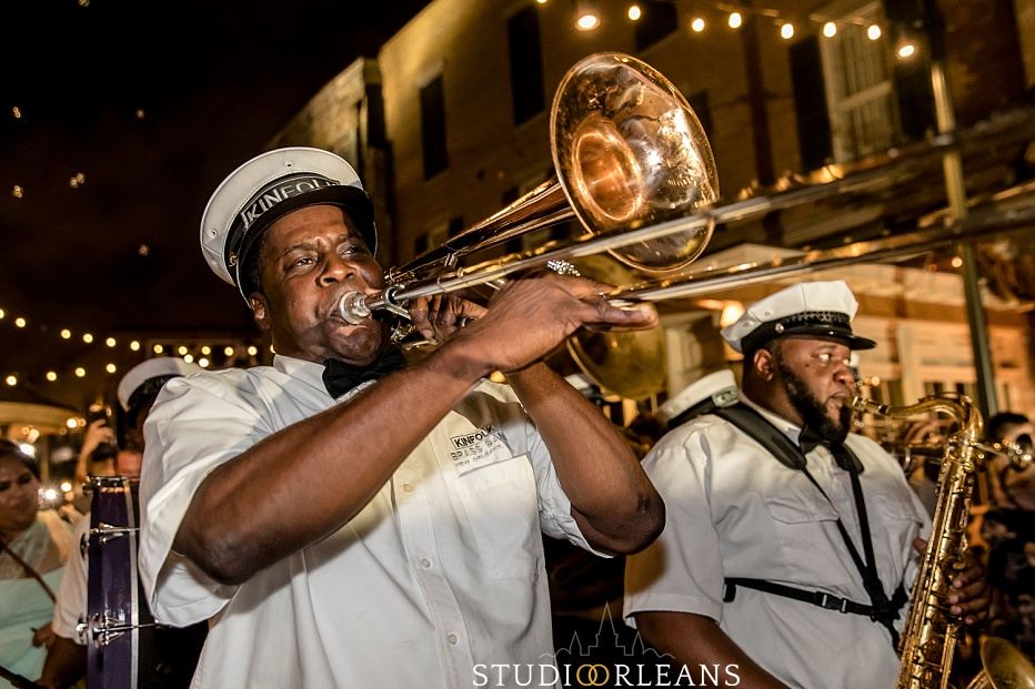 Kinfolk brass band playing for a second line on Fulton Alley in New Orleans