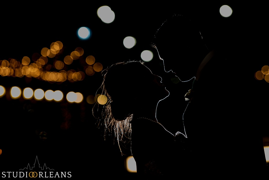 We take the couple outside for some nighttime creative portraits by Fulton Alley in New Orleans