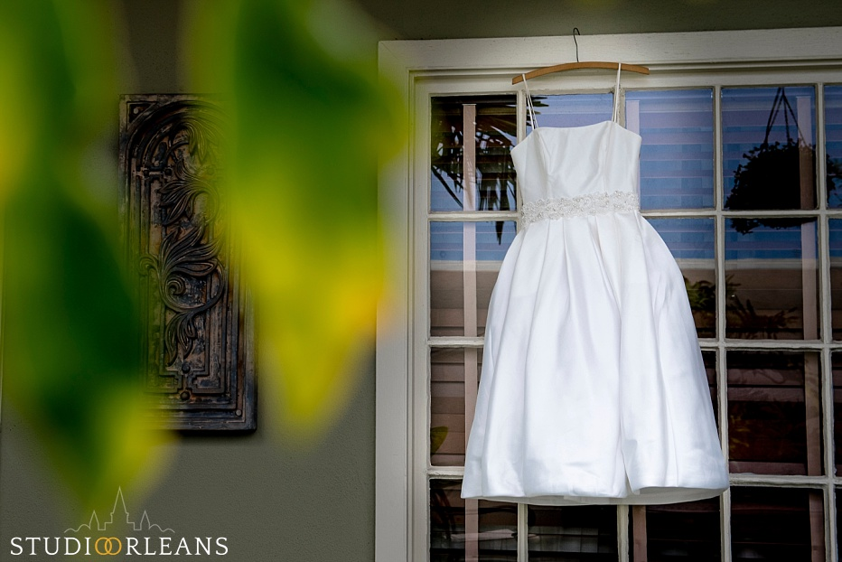Beautiful wedding dress hanging in New Orleans at the Bienville House