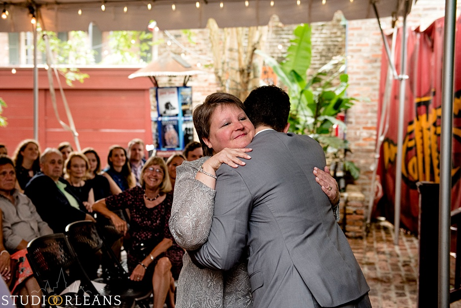 The bride hugs her mom for her wedding in New Orleans at The House of Blues wedding - Same sex wedding