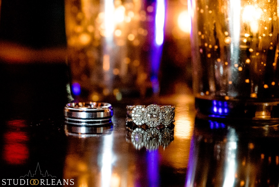 House of Blues Wedding - wedding rings on a table with pretty lights in the background